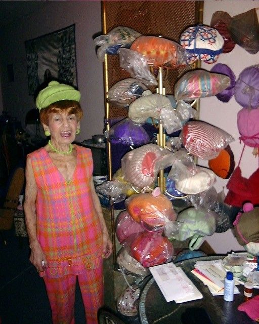 Irene with some of her hats.